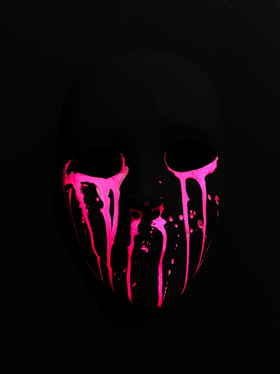 mask painted in black and crying in pink.jpg